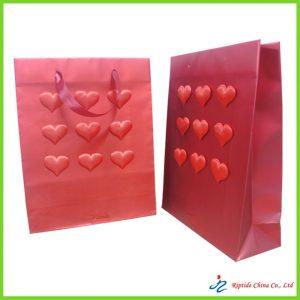 Embossed paper gift bag